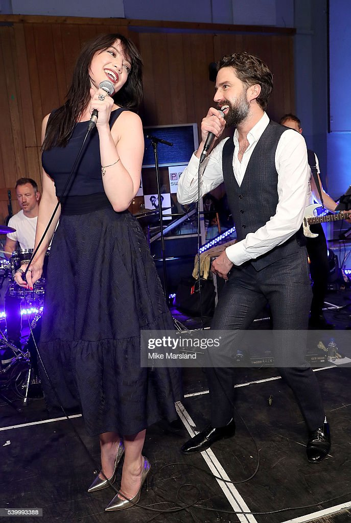 Daisy Lowe and Jack Guinness perform on stage as GQ and One For The Boys with Swatch host the London Collections Men closing night karaoke at Abbey...
