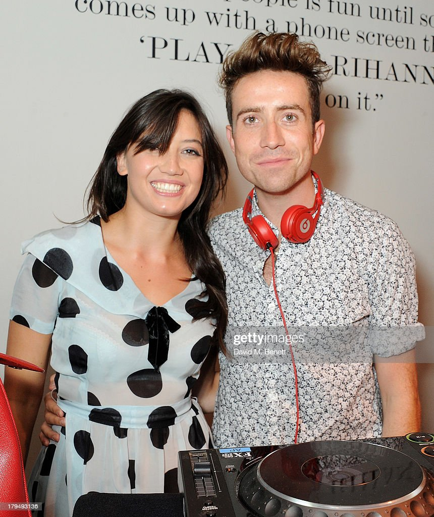 Daisy Lowe (L) and Nick Grimshaw attend the launch of Alexa Chung's first book 'It' at Liberty on September 4, 2013 in London, England.