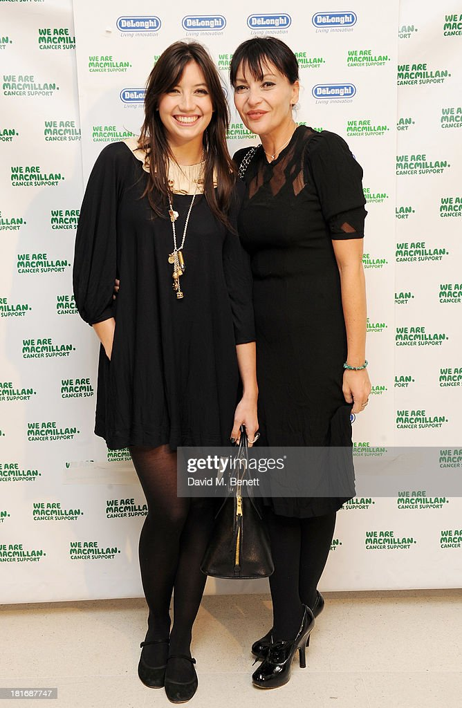 Daisy Lowe (L) and Pearl Lowe attend the Macmillan De'Longhi Art Auction, raising money for Macmillan Cancer Support, at Royal College of Art on September 23, 2013 in London, England