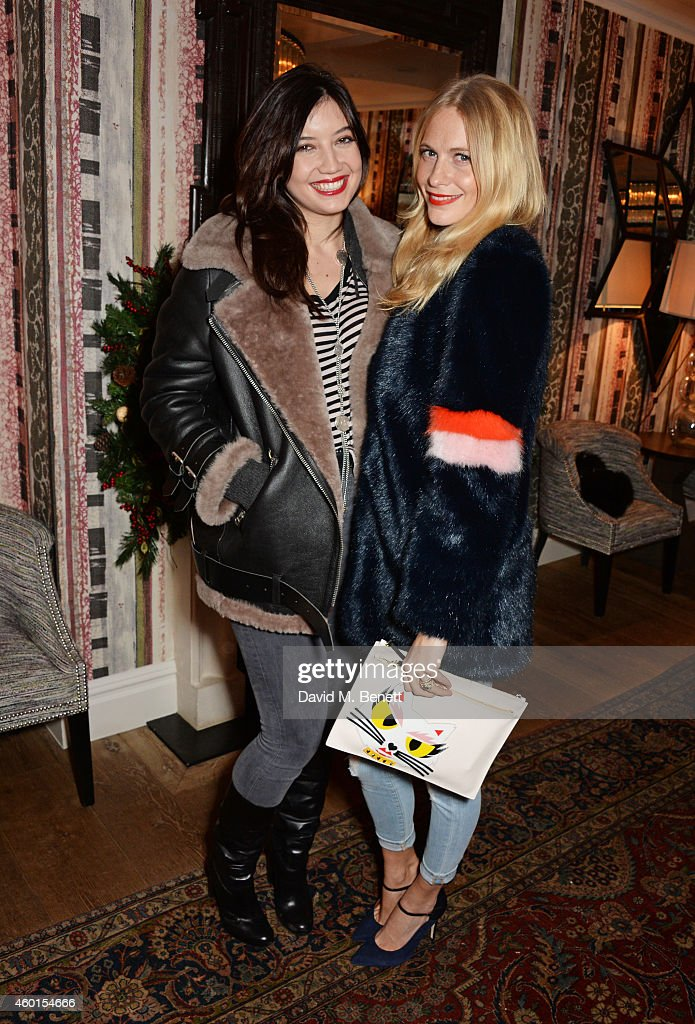 Daisy Lowe (L) and Poppy Delevingne attend a VIP screening of 'St. Vincent' hosted by Poppy Delevingne at The Covent Garden Hotel on December 8, 2014 in London, England.