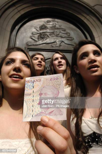 Daisy Melanie Charlotte and Laura of the classical girl group All Angels sing in protest at the image of economist Adam Smith replacing Sir Edward...