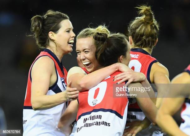Daisy Pearce of Darebin is congratulated by team mates after kicking a goal during the VFL Women's Grand Final match between Diamond Creek and...