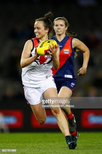 Daisy Pearce of Darebin runs with the ball during the VFL Women's Grand Final match between Diamond Creek and Darebin at Etihad Stadium on September...