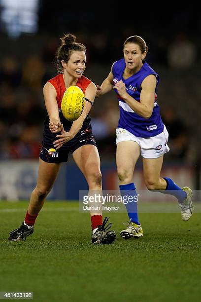 Daisy Pearce of Melbourne handballs during the women's exhibition AFL match between the Western Bulldogs and the Melbourne Demons at Etihad Stadium...