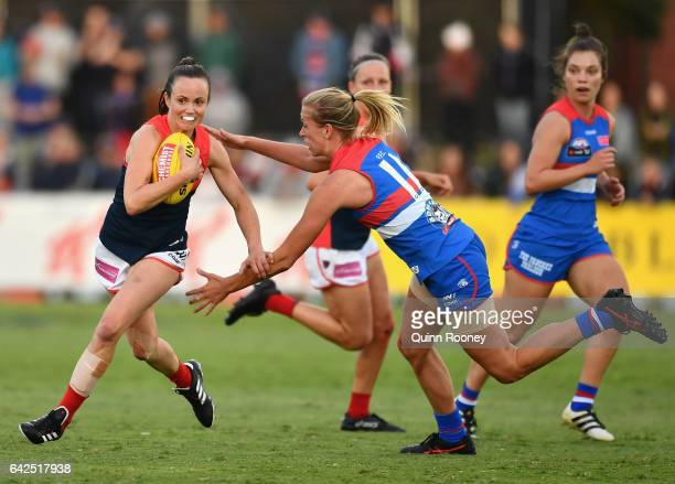 Daisy Pearce of the Demons breaks free of a tackle by Lauren Spark of the Bulldogs during the Women's round three match between the Western Bulldogs...