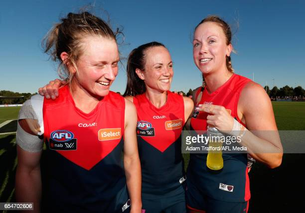 Daisy Pearce of the Demons celebrates with Shelley Scott and Laura Duryea of the Demons during the 2017 AFLW Round 07 match between the Melbourne...