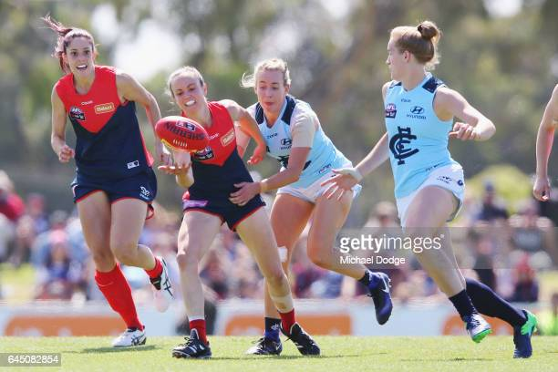 Daisy Pearce of the Demons is tackled by Lauren Arnell of the Blues during the round four Women's AFL match between the Melbourne Demons and the...