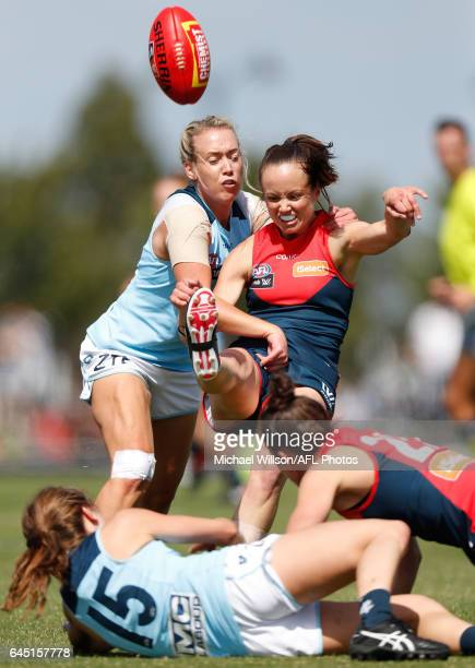 Daisy Pearce of the Demons is tackled by Lauren Arnell of the Blues during the 2017 AFLW Round 04 match between the Melbourne Demons and the Carlton...