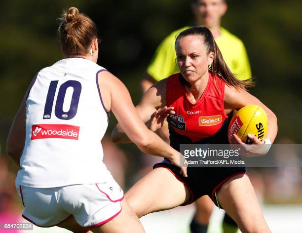 Daisy Pearce of the Demons is tackled by Stacey Barr of the Dockers during the 2017 AFLW Round 07 match between the Melbourne Demons and the...
