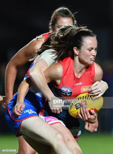 Daisy Pearce of the Demons is tackled during the Women's round three match between the Western Bulldogs and the Melbourne Demons at Whitten Oval on...