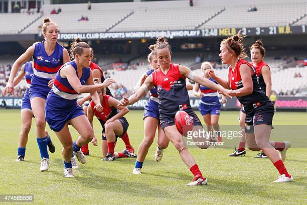 Daisy Pearce of the Demons kicks the ball during the Women's AFL exhibition match between the Melbourne Demons and the Western Bulldogs at Melbourne...