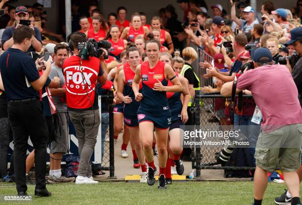 Daisy Pearce of the Demons leads her team onto the field during the 2017 AFLW Round 01 match between the Melbourne Demons and the Brisbane Lions at...