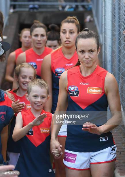 Daisy Pearce of the Demons leads her team out onto the field during the Women's round three match between the Western Bulldogs and the Melbourne...