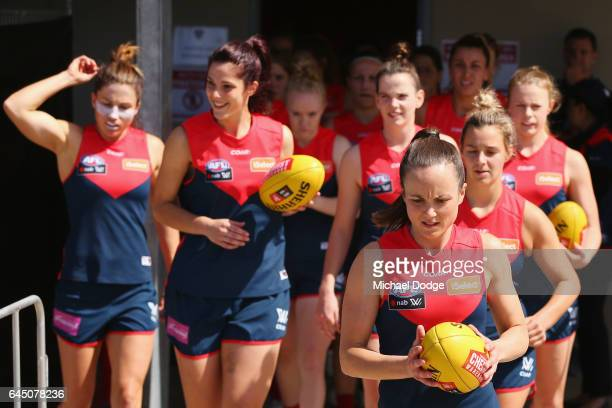 Daisy Pearce of the Demons leads the team out during the round four Women's AFL match between the Melbourne Demons and the Carlton Blues at Casey...