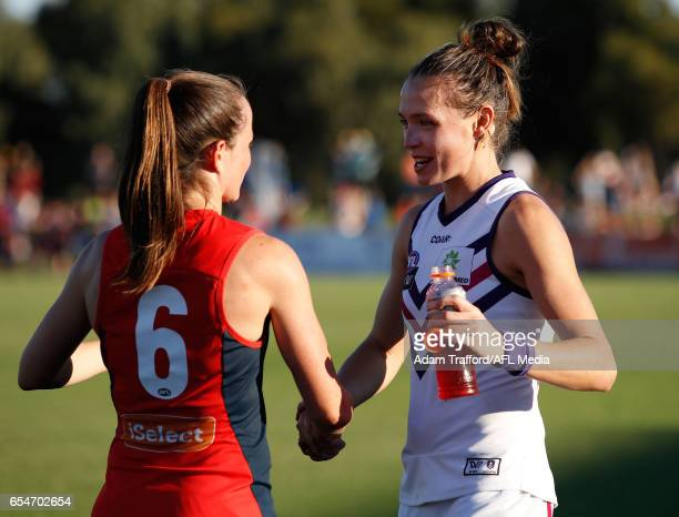 Daisy Pearce of the Demons shakes hands with Ebony Antonio of the Dockers during the 2017 AFLW Round 07 match between the Melbourne Demons and the...