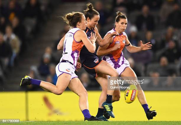 Daisy Pearce of Victoria kicks whilst being tackled by Emma Swanson of the Allies during the AFL Women's State of Origin match between Victoria and...