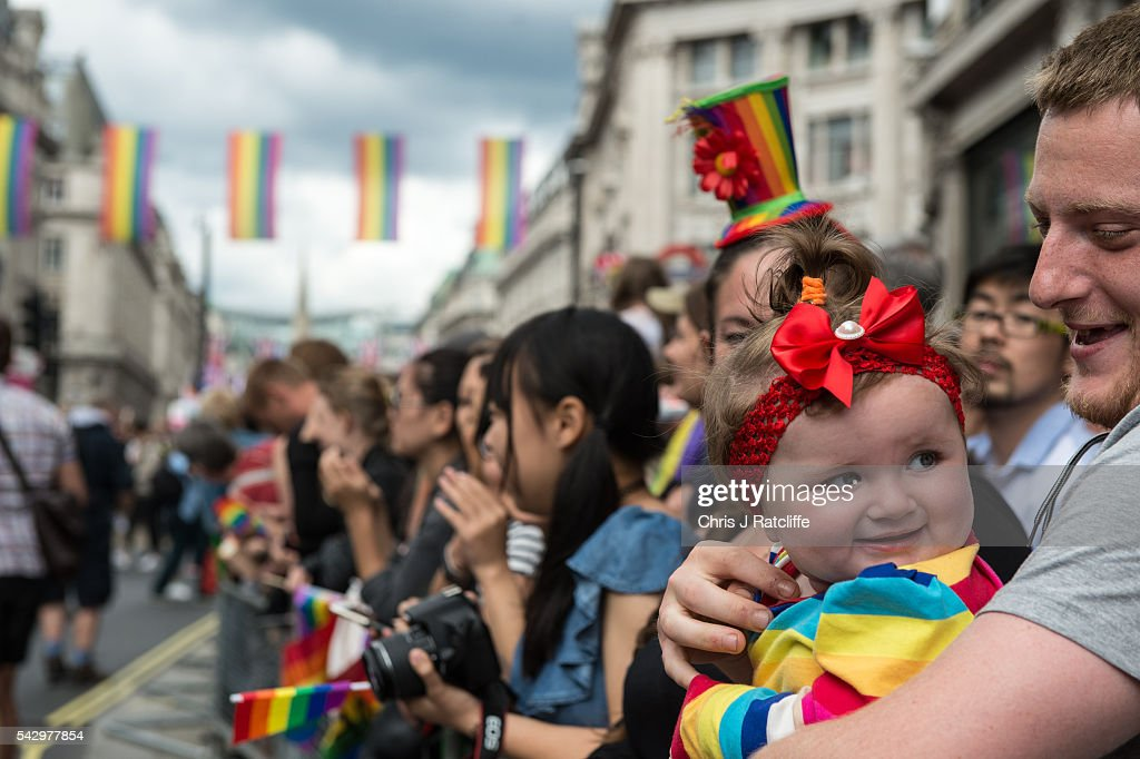 Daisy Thwait, 1, watches the Pride parade with her father as the LGBT community celebrates Pride in London on June 25, 2016 in London, England. Across the city performances and speeches take place as a parade makes it way through the centre ending in Trafalgar Square. 2016 Pride in London comes just two weeks after Omar Mateen shot dead 50 people at Pulse, a gay nightclub in Orlando, Florida.
