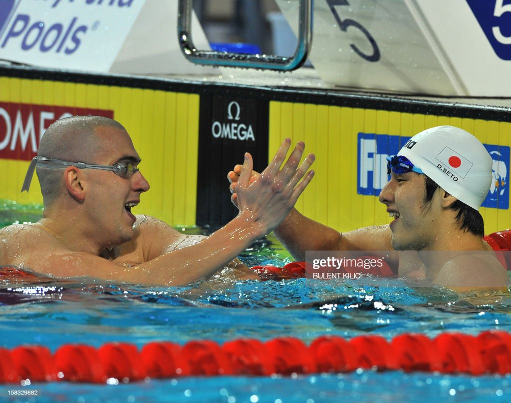 Daiya Seto of Japan (R) celebrates with Laszlo Cseh of Hungary (L) after winning the Men's 400m individual medley final on December 13, 2012 at the FINA World Short Course Swimming Championships in Istanbul.