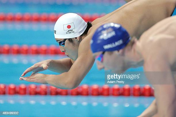 Daiya Seto of Japan dives in to start the Men's 400m Individual Medley Final on day sixteen of the 16th FINA World Championships at the Kazan Arena...