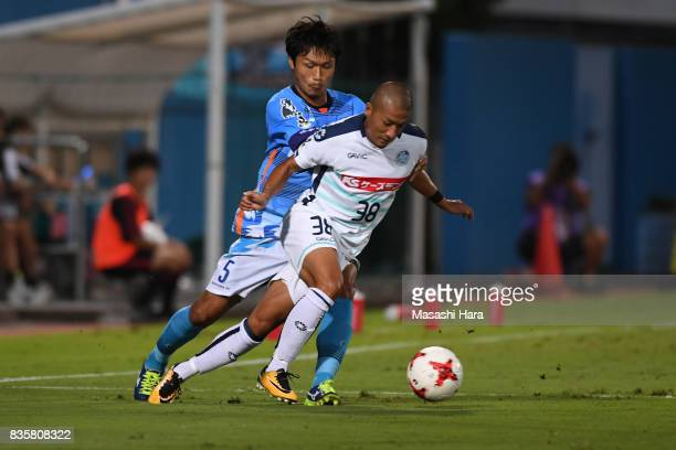 Daizen Maeda of Mito Hollyhock and Shogo Nishikawa compete for the ball during the JLeague J2 match between Yokohama FC and Mito Hollyhock at...