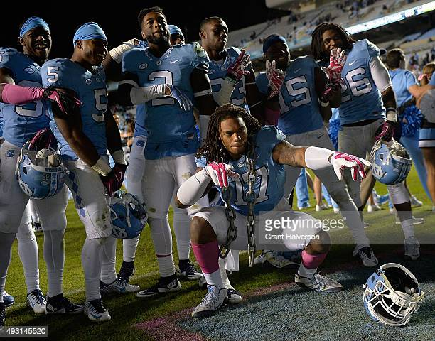 Dajaun Drennon of the North Carolina Tar Heels celebrates with teammates after a win against the Wake Forest Demon Deacons at Kenan Stadium on...