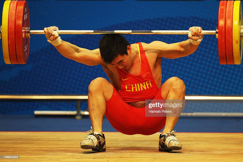 Dajin Su of China fails to lift during the Men's Weightlifting 77kg competition during day four of the 16th Asian Games Guangzhou 2010 at Dongguan Gymnasium on November 16, 2010 in Guangzhou, China.