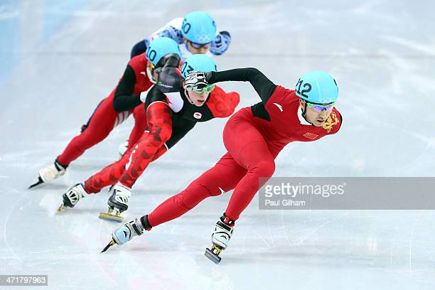 Dajing Wu of China leads the pack in the Short Track Men's 500m Final A on day fourteen of the 2014 Sochi Winter Olympics at Iceberg Skating Palace...