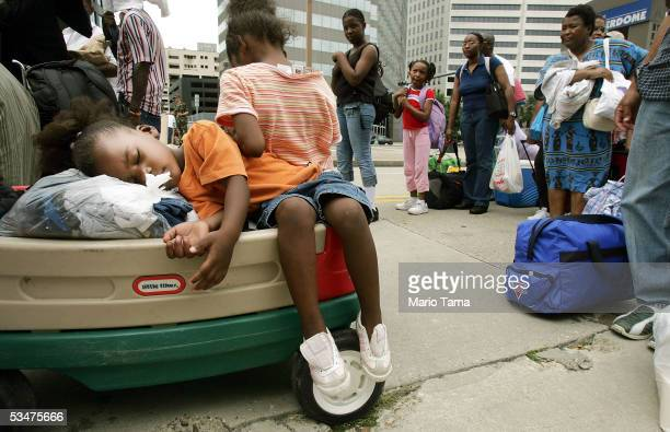 Dajonay Redett sleeps as her family waits in line to enter the Superdome which is being used as an emergency shelter before the arrival of Hurricane...