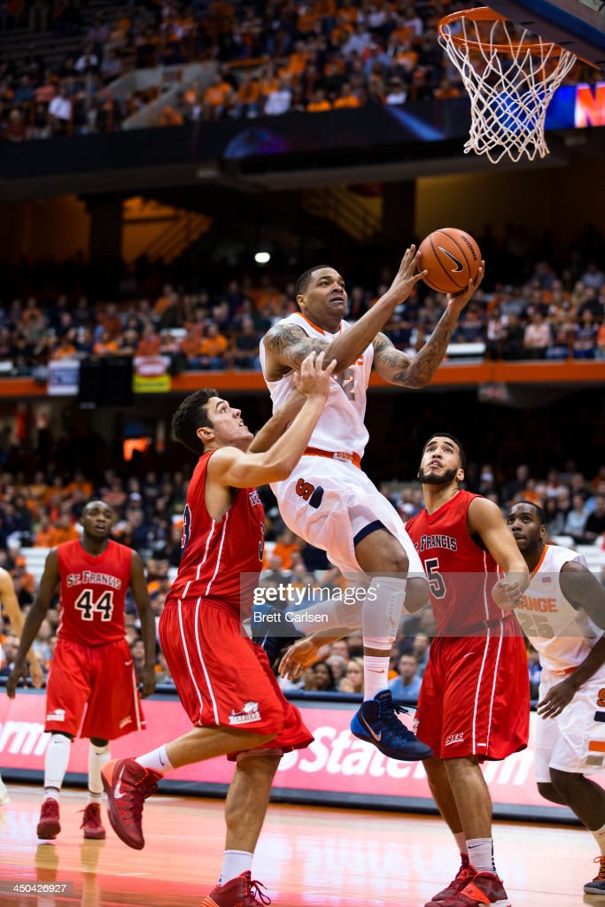 Dajuan Coleman #32 of Syracuse Orange puts in two points during the first half of a basketball game against St Francis Terriers on November 18, 2013 at the Carrier Dome in Syracuse, New York.