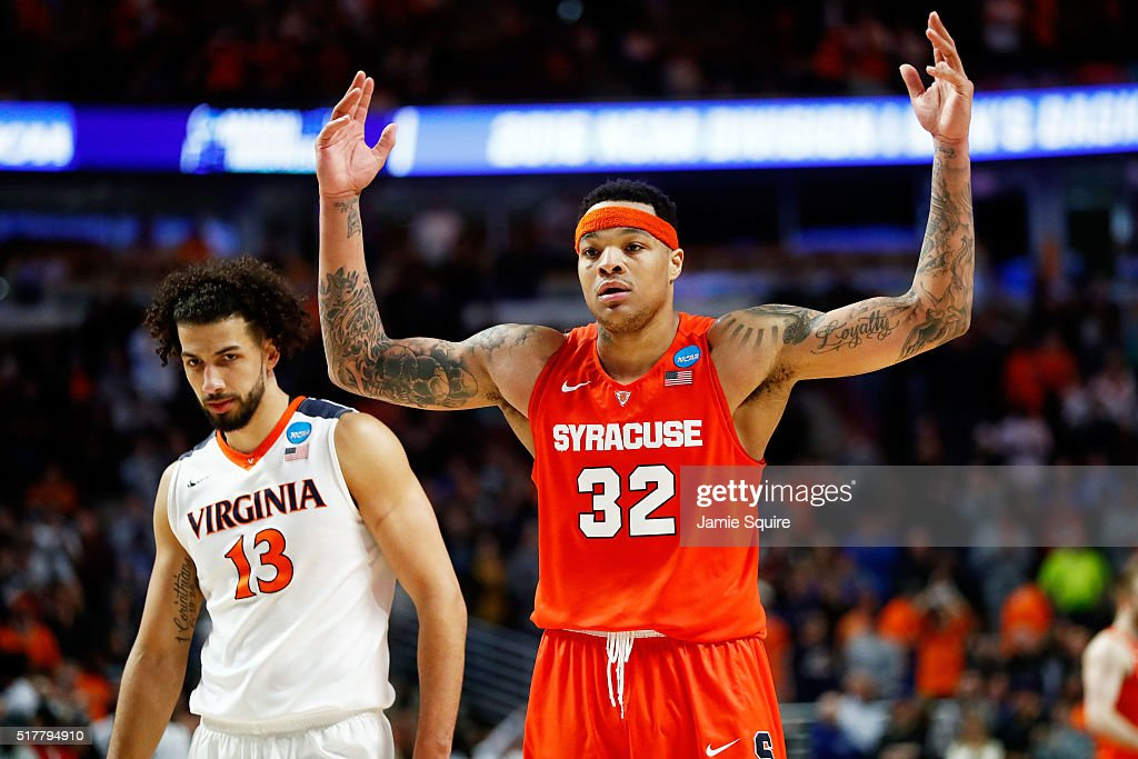 DaJuan Coleman of the Syracuse Orange celebrates in the final moments of their 68 to 62 win over the Virginia Cavaliers during the 2016 NCAA Men's...