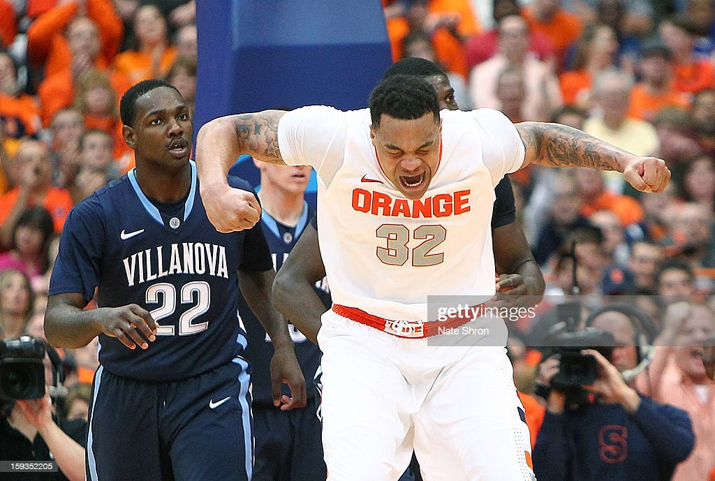 DaJuan Coleman #32 of the Syracuse Orange reacts after a play during their win over the Villanova Wildcats during the game at the Carrier Dome on January 12, 2013 in Syracuse, New York.