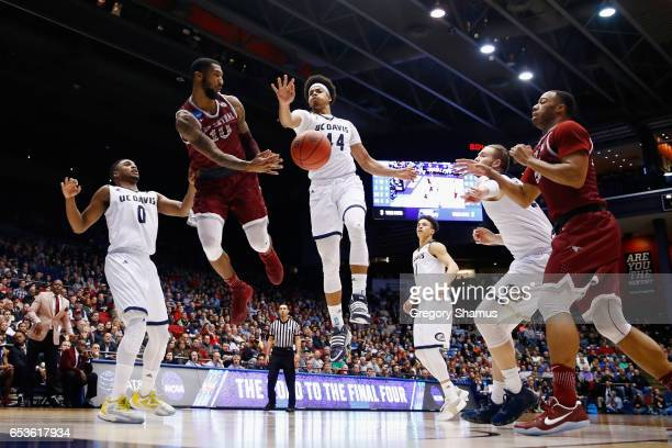 Dajuan Graf of the North Carolina Central Eagles passes the ball against Garrison Goode of the UC Davis Aggies in the second half during the First...