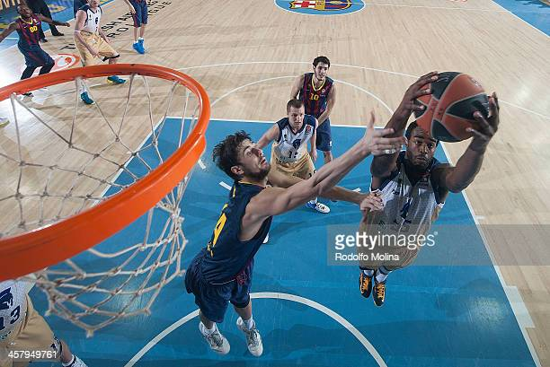 Dajuan Summers #35 of Budivelnik Kiev competes with Ante Tomic #44 of FC Barcelona during the 20132014 Turkish Airlines Euroleague Regular Season...