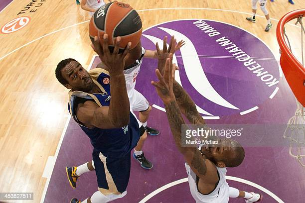 Dajuan Summers #35 of Budivelnik Kiev competes with Tarence Kinsey #21 of Partizan NIS Belgrade during the 20132014 Turkish Airlines Euroleague...