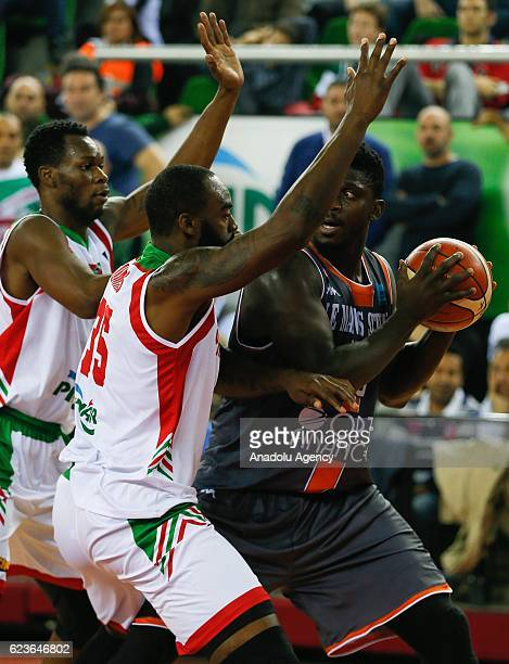 DaJuan Summers of Pinar Karsiyaka and Will Yeguete of Le Mans vie for the ball during their Basketball Champions League Group B match at Mustafa...