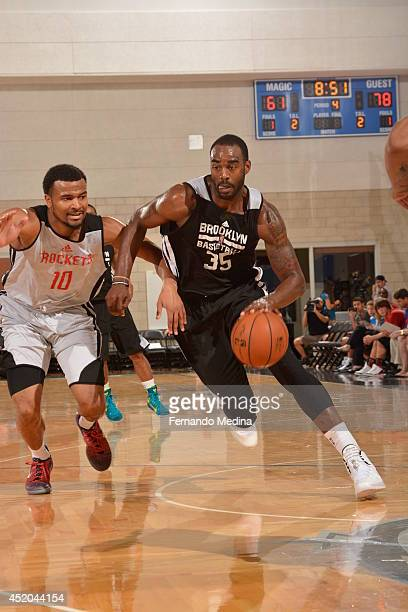 DaJuan Summers of the Brooklyn Nets drives to the basket against the Houston Rockets during the game during the Samsung NBA Summer League 2014 on...