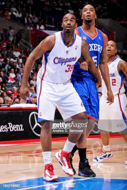 DaJuan Summers of the Los Angeles Clippers battles for rebound position against Arnett Moultrie of the Philadelphia 76ers in his debut game for the...