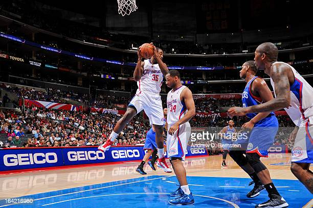 DaJuan Summers of the Los Angeles Clippers grabs a rebound in his debut game for the team against the Philadelphia 76ers at Staples Center on March...