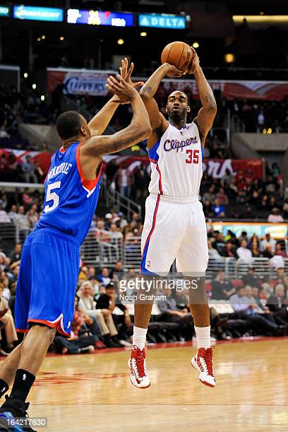 DaJuan Summers of the Los Angeles Clippers shoots in his debut game for the team against Arnett Moultrie of the Philadelphia 76ers Staples Center on...