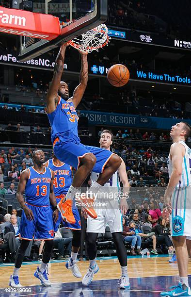 DaJuan Summers of the New York Knicks dunks against the Charlotte Hornets on October 17 2015 at Time Warner Cable Arena in Charlotte North Carolina...