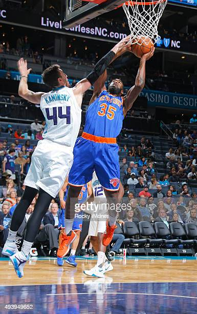 DaJuan Summers of the New York Knicks shoots against Frank Kaminsky of the Charlotte Hornets on October 17 2015 at Time Warner Cable Arena in...