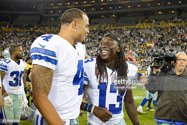 Dak Prescott and Lucky Whitehead of the Dallas Cowboys speak after a win of the game against the Green Bay Packers on October 16 2016 at Lambeau...