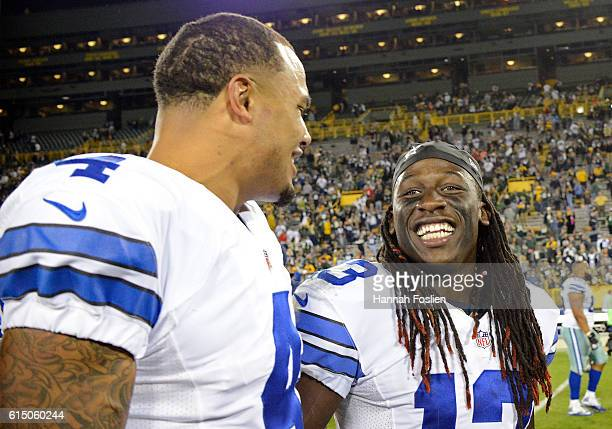 Dak Prescott celebrates with teammate Lucky Whitehead of the Dallas Cowboys after defeating the Green Bay Packers at Lambeau Field on October 16 2016...