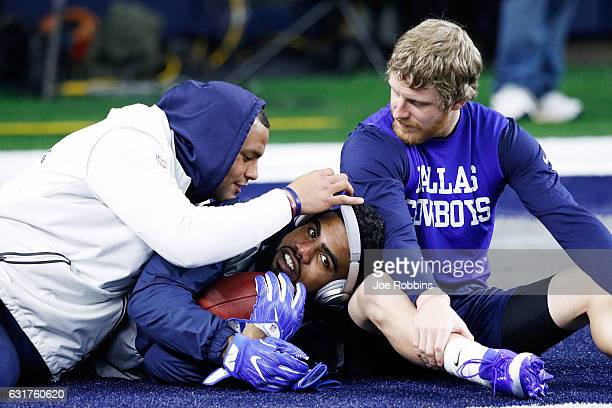 Dak Prescott Ezekiel Elliott and Cole Beasley of the Dallas Cowboys relax before the NFC Divisional Playoff Game against the Green Bay Packers at ATT...