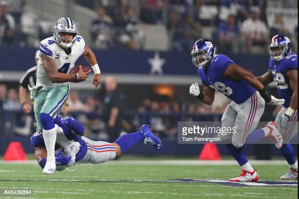 Dak Prescott of the Dallas Cowboys carries the ball against Olivier Vernon of the New York Giants in the second quarter at ATT Stadium on September...