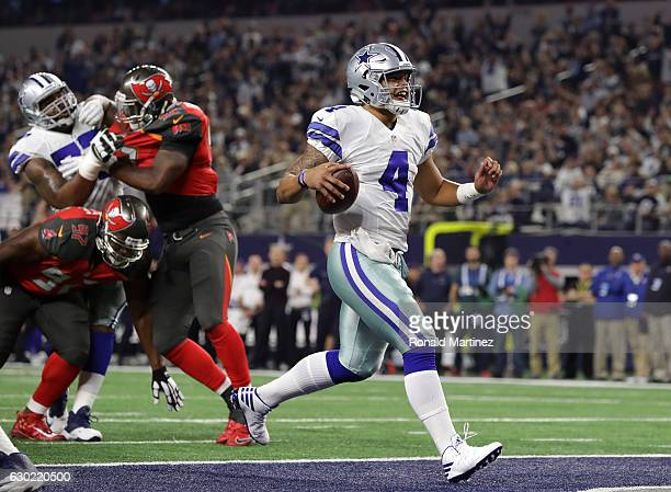Dak Prescott of the Dallas Cowboys carries the ball into the end zone to score a touchdown during the second quarter against the Tampa Bay Buccaneers...