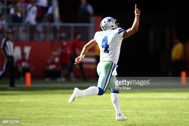 Dak Prescott of the Dallas Cowboys celebrates after a 72yard touchdown run by Ezekiel Elliott against the San Francisco 49ers during their NFL game...