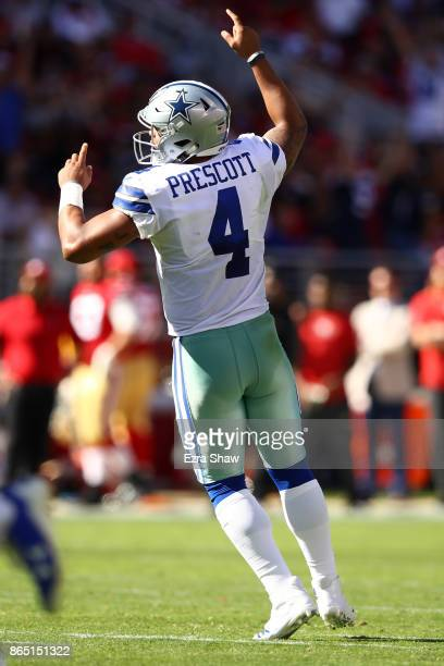 Dak Prescott of the Dallas Cowboys celebrates after an 18yard touchdown looks to pass against the San Francisco 49ers during their NFL game at Levi's...