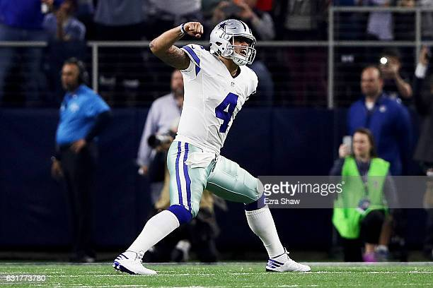 Dak Prescott of the Dallas Cowboys celebrates after scoring a touchdown in the second half during the NFC Divisional Playoff Game against the Green...
