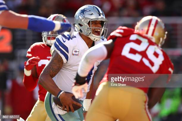 Dak Prescott of the Dallas Cowboys celebrates after scoring a touchdown on a twoyard run against the San Francisco 49ers during their NFL game at...